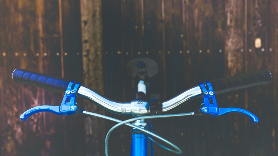 a bicycle leaning against a blue sky