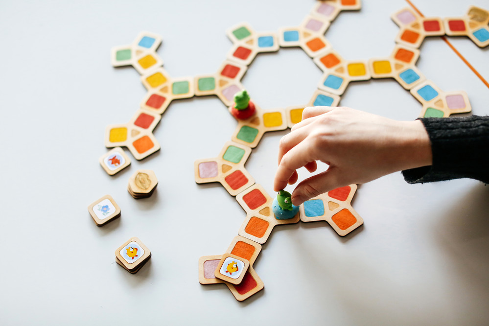 a hand playing a game