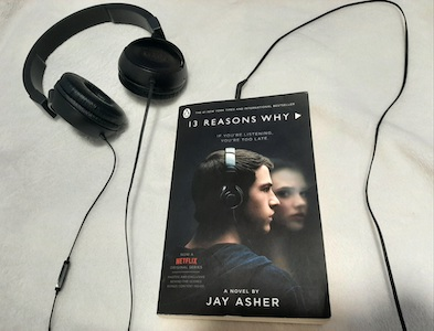 a book with headphones next to it