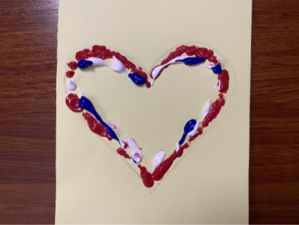 paper with a heart made of paint