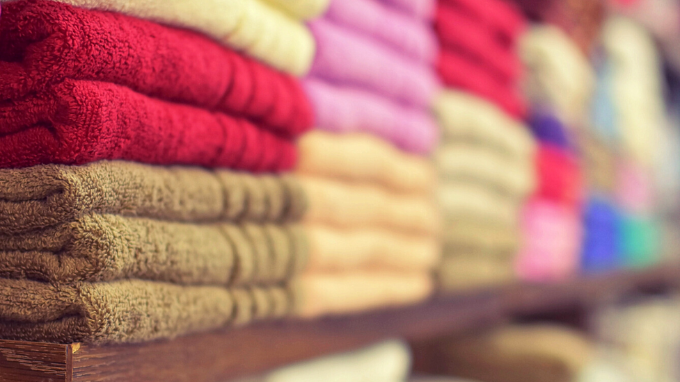a close up of different coloured towels