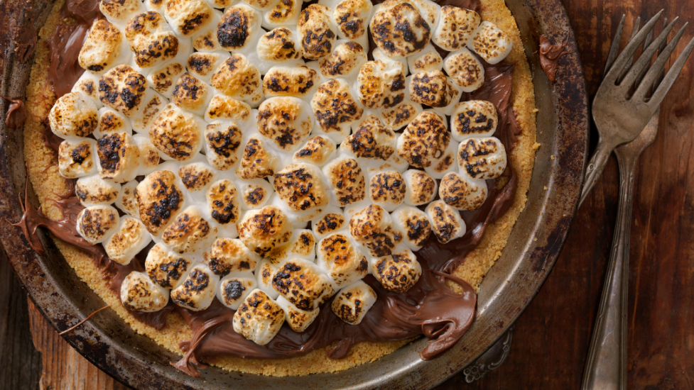 a dessert pizza sitting on top of a wooden table