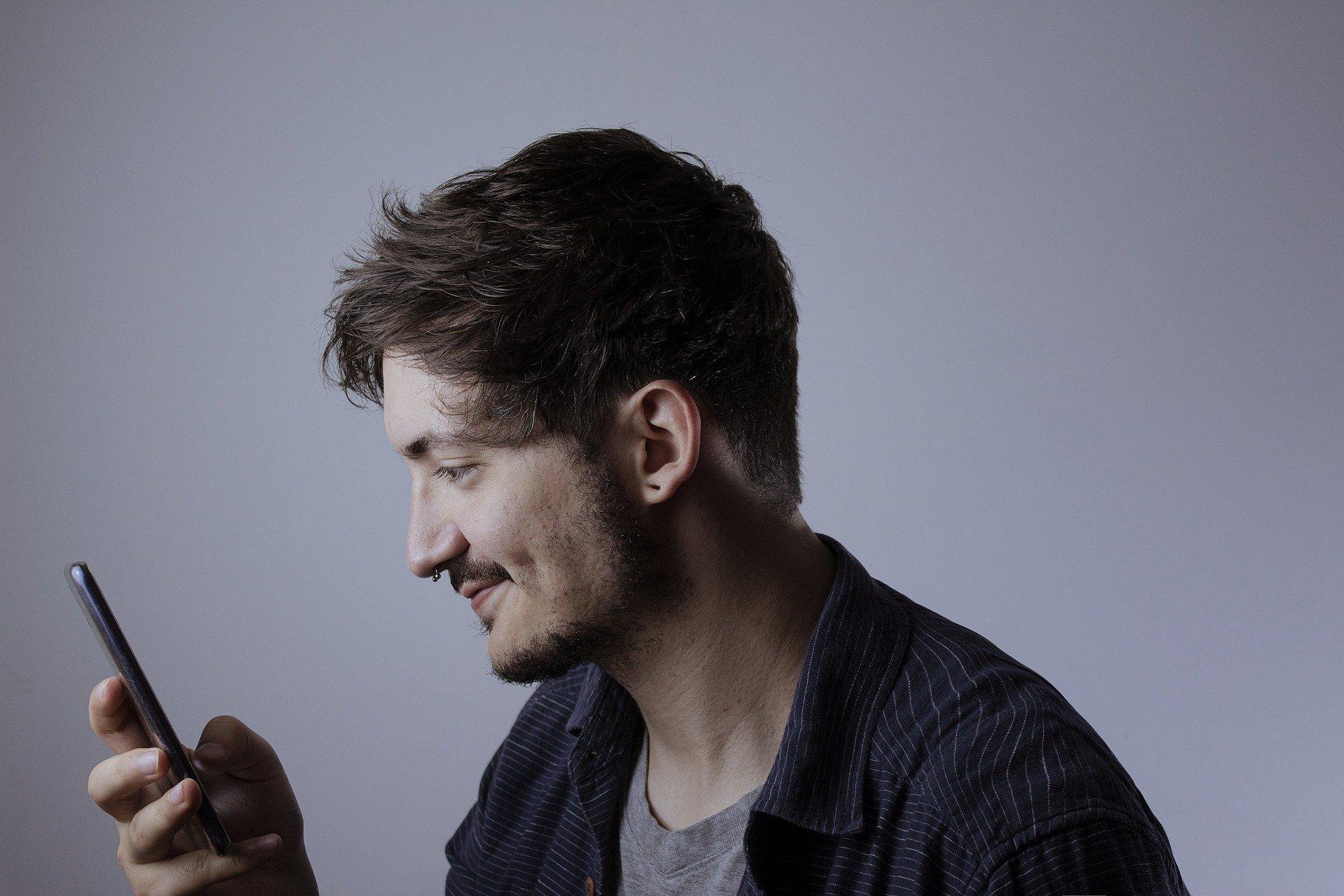 a man looking at phone