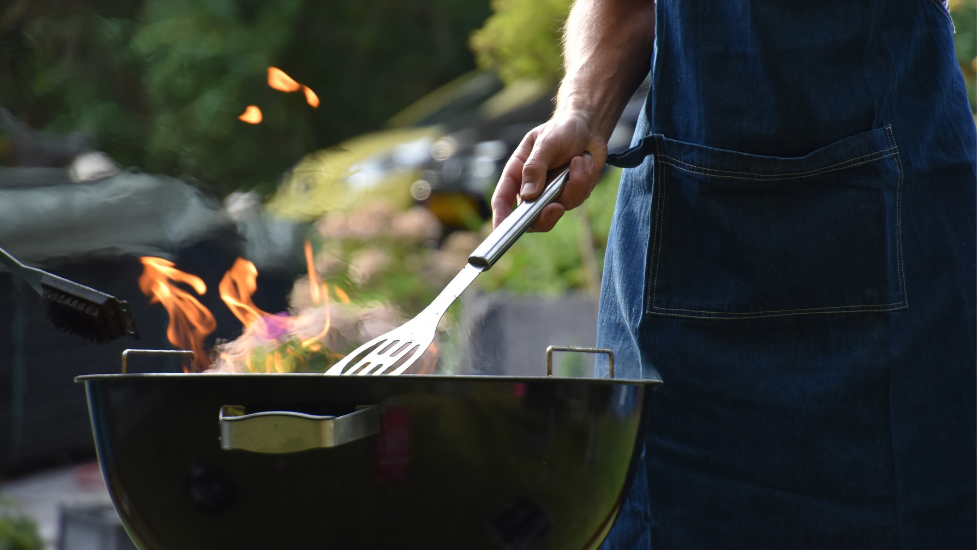 a person using a BBQ
