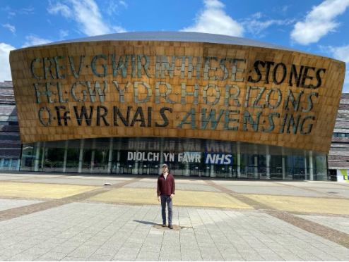 a person standing in front of the Wales Millennium Centre