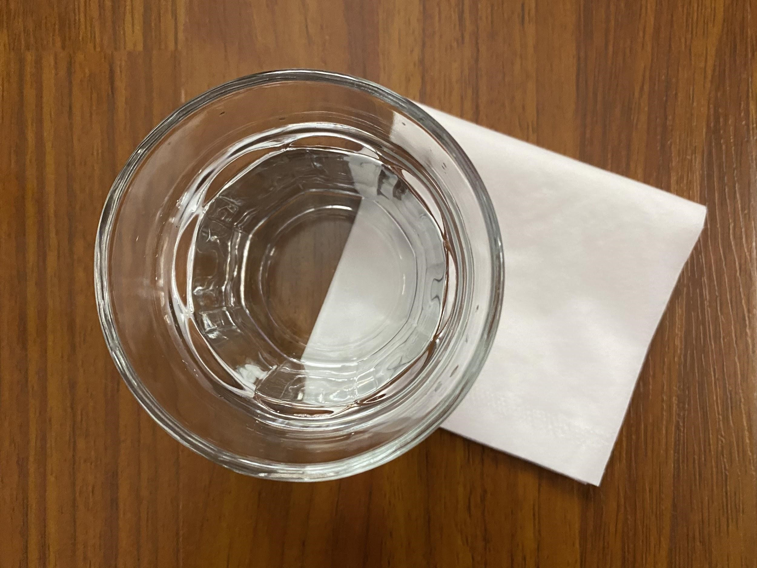 a close up of a bowl of water on a table