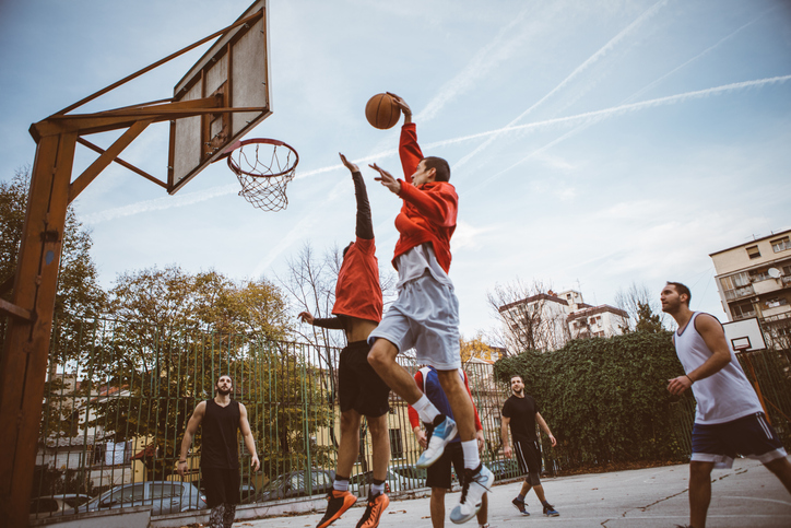 a group of people playing a game of basketball