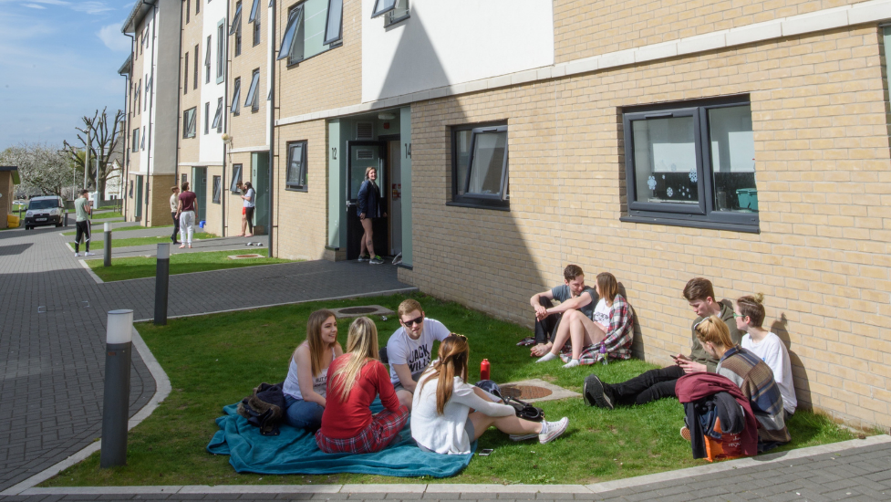 a group of people sitting in front of a building