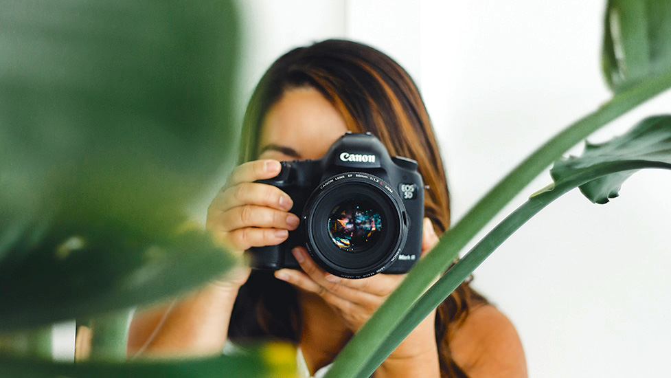a person holding a camera