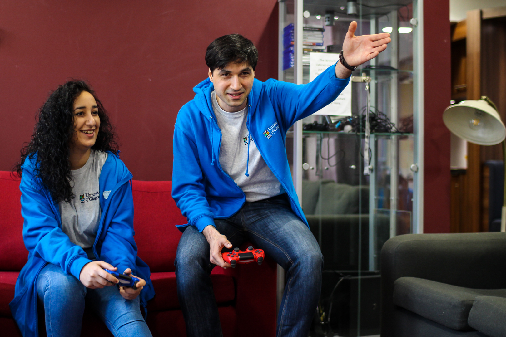 Two Living Support Assistants playing playstation