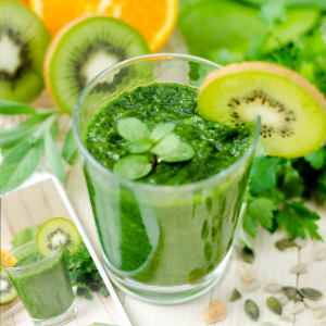a close up of a green juice in a glass